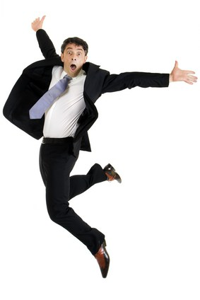 Agile businessman leaping in the air