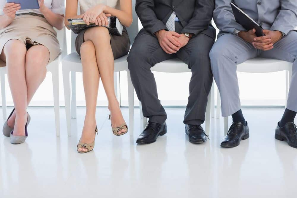 Low section of business people waiting for job interview in a bright office
