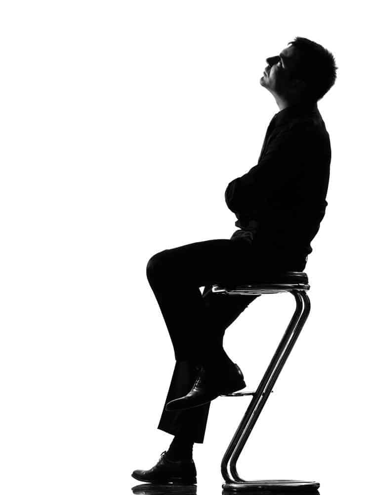 silhouette man thinking pensive full length looking up